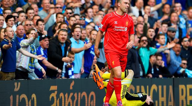 Rickie Lambert of Liverpool is haranged by the chelsea fans
