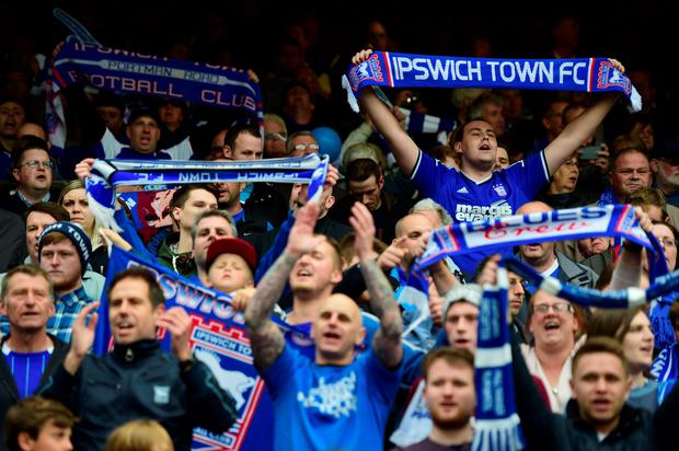 IPSWICH, ENGLAND - MAY 09: Ipswich fans show their support during the Sky Bet Championship Playoff semi-final first leg match between Ipswich Town and Norwich Cityat Portman Road on May 9, 2015 in Ipswich, England. (Photo by Jamie McDonald/Getty Images)