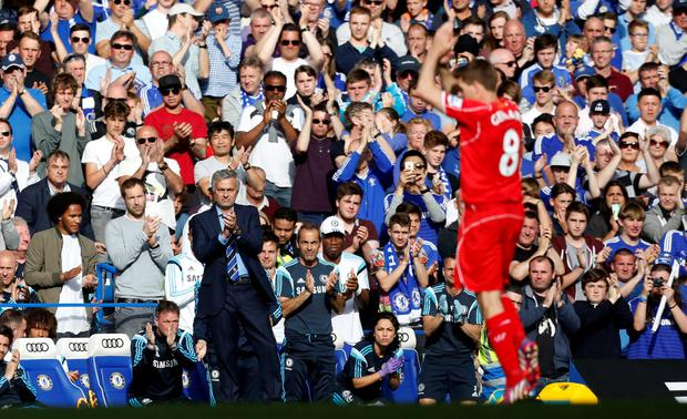 Chelsea's Portuguese manager Jose Mourinho (L) leads the applause after Liverpool's English midfielder Steven Gerrard (R) is substituted during the English Premier League football match between Chelsea and Liverpool at Stamford Bridge in London on May 10, 2015. AFP PHOTO / IAN KINGTON RESTRICTED TO EDITORIAL USE. No use with unauthorized audio, video, data, fixture lists, club/league logos or live services. Online in-match use limited to 45 images, no video emulation. No use in betting, games or single club/league/player publications.IAN KINGTON/AFP/Getty Images