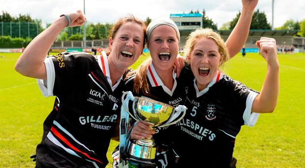 Sligo players, left to right, Jacqui Mulligan, Ruth Goodwin and Colley Casey celebrate with the cup