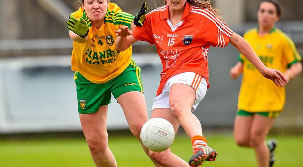 Armagh's Aimee Mackin scores a first-half goal despite the efforts of Donegal's Nicole McLaughlin in their Division 2 final