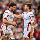 Ulster's Iain Henderson, left, is consoled by team-mate Stuart McCloskey after being shown a red card. Guinness PRO12, Round 21, Ulster v Munster (Ramsey Cardy / SPORTSFILE)