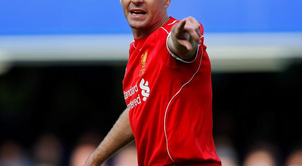 Liverpool captain Steven Gerrard issues instructions during his side's clash with Chelsea at Stamford Bridge yesterday