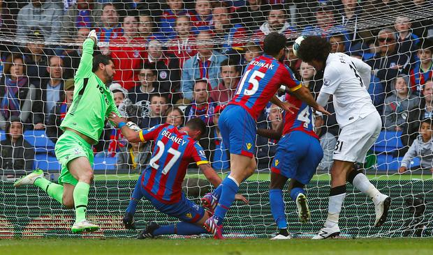 Marouane Fellaini heads the winning goal into the Crystal Palace net