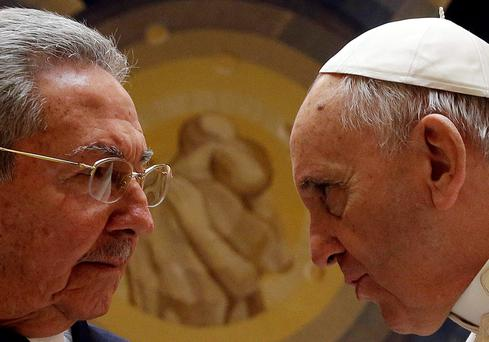 Pope Francis talks to Cuban President Raul Castro during a private audience at the Vatican