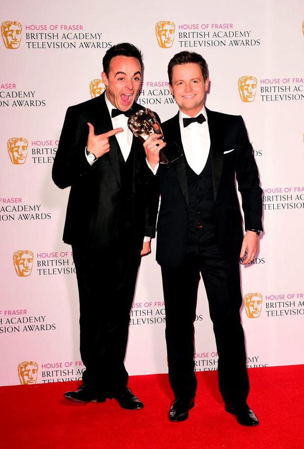 Anthony McPartlin (left) and Declan Donnelly with the Best Entertainment Programme Award for Ant and Dec??s Saturday Night Takeaway at the House of Fraser British Academy of Television Awards at the Theatre Royal, Drury Lane in London