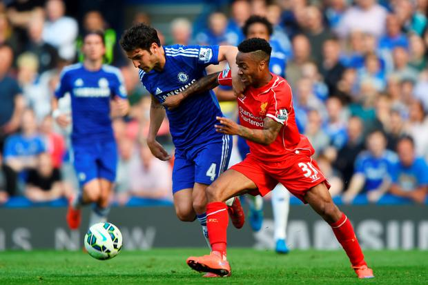 Cesc Fabregas of Chelsea and Raheem Sterling of Liverpool