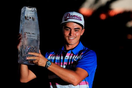 Rickie Fowler celebrates with the winner's trophy after the final round of THE PLAYERS Championship