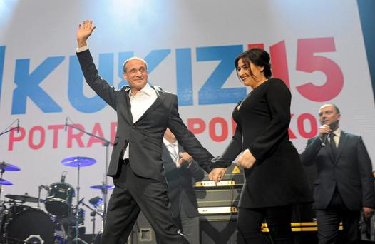 Pawel Kukiz (R) presidential candidate and former rock musician appears on stage with his wife Malgorzata (R) after the announcement of the first exit polls in the first round of the Polish presidential elections, at his election campaign headquarters in Lubin, Poland. Reuters/Kornelia Glowacka-Wolf/Agencja Gazeta