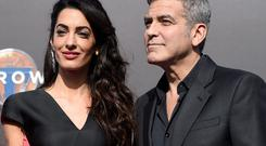Amal and George Clooney arrive at the world premiere of