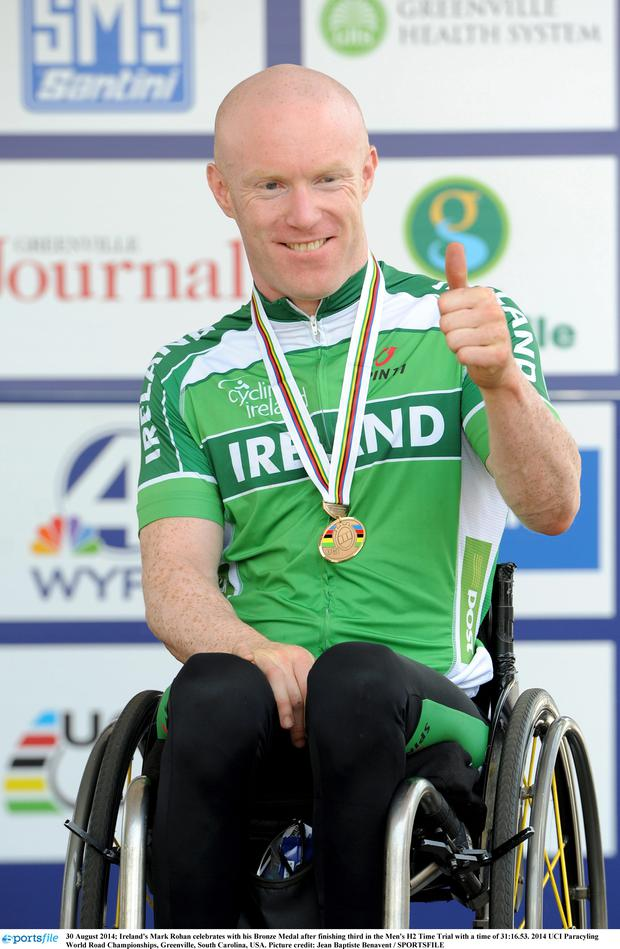 Ireland's Mark Rohan celebrates with his Bronze Medal after finishing third in the Men's H2 Time Trial with a time of 31:16.53. 2014 UCI Paracyling World Road Championships