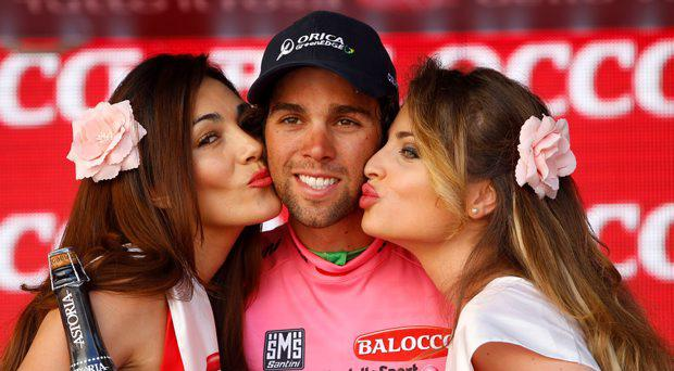 Australian overall leader Michael Matthews celebrates his pink jersey on the podium of the 2nd stage of the 98th Giro (Tour of Italy) on May 10, 2015 in Genova
