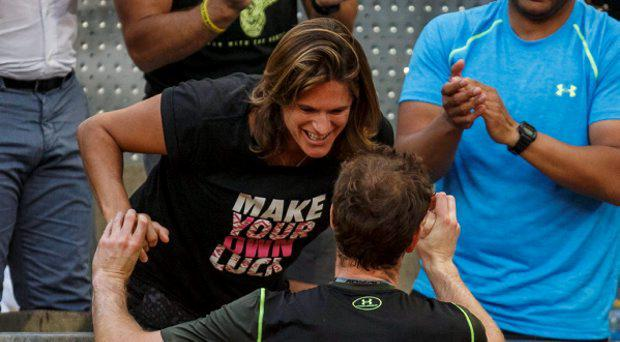 Britain's Andy Murray is congratulated by his coach and former tennis player Amelie Mauresmo after his victory over Spain's Rafael Nadal during their final match at the Madrid Open tennis tournament in Madrid, Spain, May 10, 2015. REUTERS/Sergio Perez