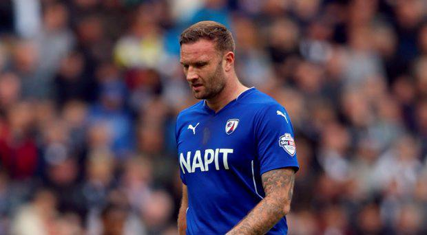 A man has been arrested on suspicion of assaulting Chesterfield captain Ian Evatt at the end of the League One play-off semi-final second leg at Preston on Sunday