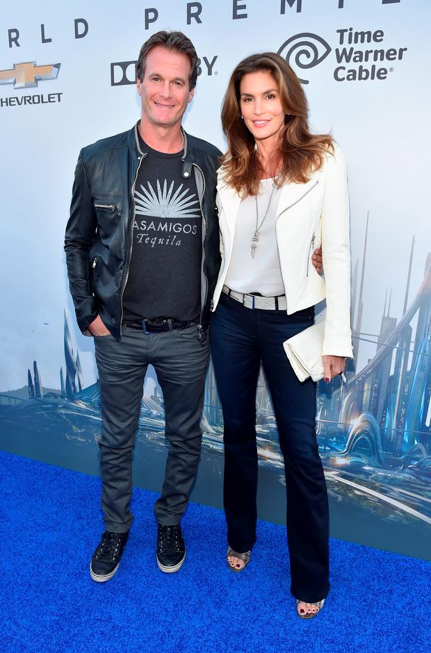 Randy Gerber (L) and model Cindy Crawford attend the world premiere of Disney's