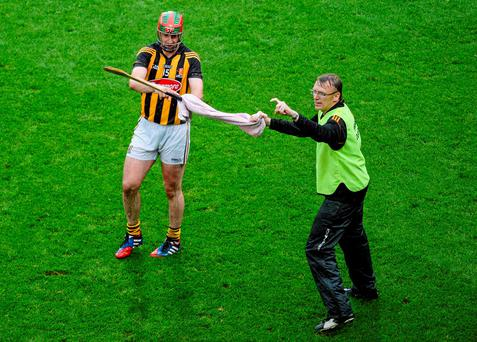 Kilkenny doctor Dr. Tadhg Crowley – seen here helping Eoin Larkin – believes that any player testing positive could be an 'accidental issue'