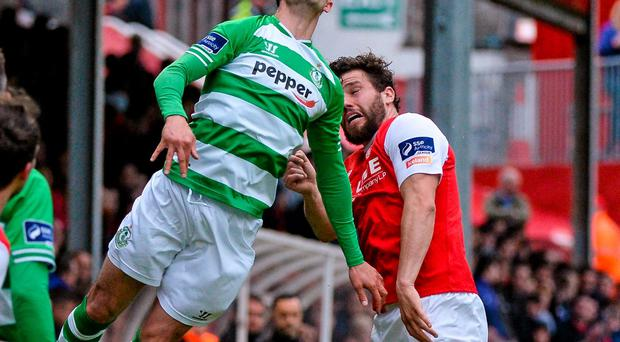 Shamrock Rovers Keith Fahey wins the aerial duel ahead of St Pat's James Chambers at Richmond Park last night