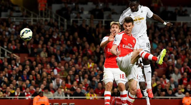 Swansea's Bafetimbi Gomis scores the winning goal against Arsenal at the Emirates last night