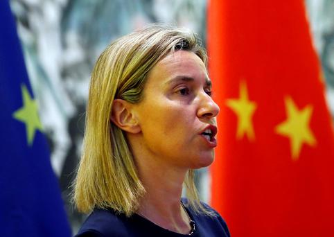 'Last night, the EU foreign policy chief Federica Mogherini pleaded for UN help to dismantle the criminal groups behind this tragic trafficking. She shouldn't have to plead' (REUTERS/Kim Kyung-Hoon)