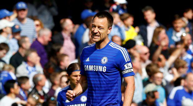 John Terry celebrates after scoring the first goal for Chelsea