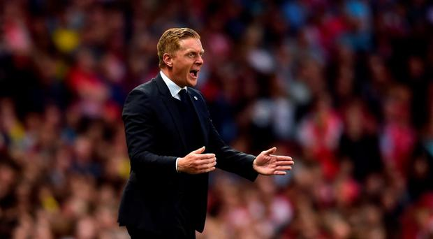 Manager Garry Monk of Swansea City gives instructions during the Barclays Premier League match between Arsenal and Swansea City at the Emirates