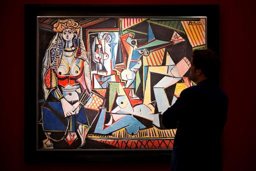 A man pauses to look at Pablo Picasso's