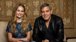 Cast members George Clooney and Britt Robertson pose for a portrait while promoting their upcoming movie