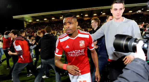 Swindon Town's Jonathan Obika is congratulated by fans as he leaves the field of play after the Sky Bet League One, Play Off Semi Final, Second Leg at the County Ground, Swindon