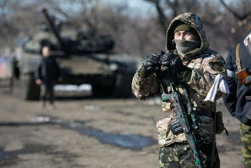 A fighter with the separatist self-proclaimed Donetsk People's Republic Army Credit: Baz Ratner