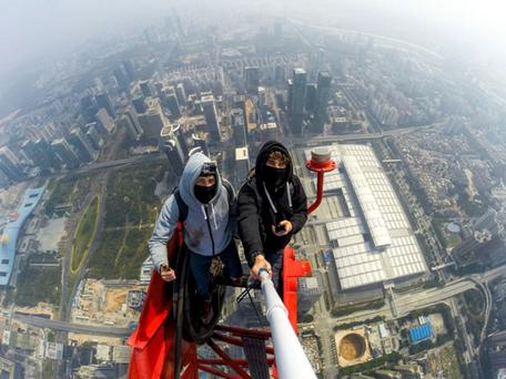 Vitaliy Raskalov (21) and Vadim Makhorov (25) taking in the sights 660 metres up Credit: On The Roofs