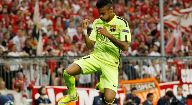 Neymar celebrates scoring the second goal for Barcelona