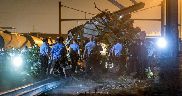 Rescue workers search for victims in the wreckage of a derailed Amtrak train in Philadelphia, Pennsylvania May 12, 2015. The Amtrak passenger train with more than 200 passengers on board derailed in north Philadelphia on Tuesday night, killing at least five people and injuring more than 50 others, several of them critically, authorities said. Authorities said they had no idea what caused the train wreck, which left some demolished rail cars strewn upside down and on their sides in the city's Port Richmond neighborhood along the Delaware River. REUTERS/Bryan Woolston