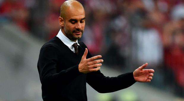 Josep Guardiola reacts during the Champions League semi final second leg match between Bayern Munich and Barcelona