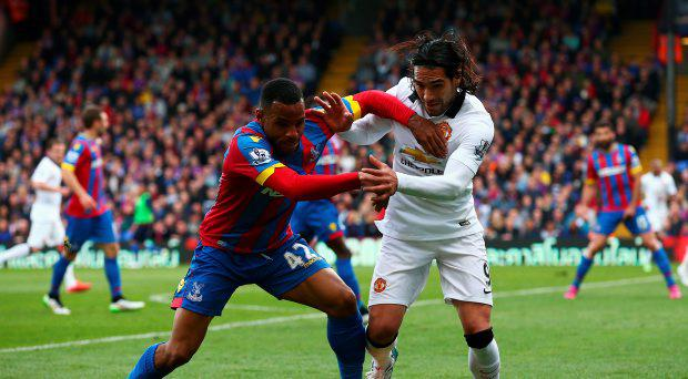 Jason Puncheon of Crystal Palace challenges Radamel Falcao of Manchester United