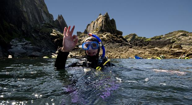A diver on the surface of the water along Cork coast
