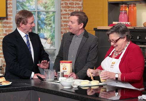 Taoiseach Enda Kenny lends a hand in the kitchen with Alan Hughes and Catherine Leyden on Ireland AM