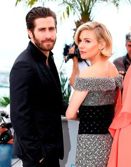Jury members Jake Gyllenhaal and Sienna Miller attend the Jury photocall during the 68th annual Cannes Film Festival on May 13, 2015 in Cannes, France. (Photo by Andreas Rentz/Getty Images)