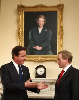 British Prime Minister David Cameron and Taoiseach Enda Kenny in Downing Street, meeting beneath a portrait of Margaret Thatcher