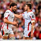 Ulster's Iain Henderson, left, is consoled by team-mate Stuart McCloskey after being shown a red card against Munster last Saturday