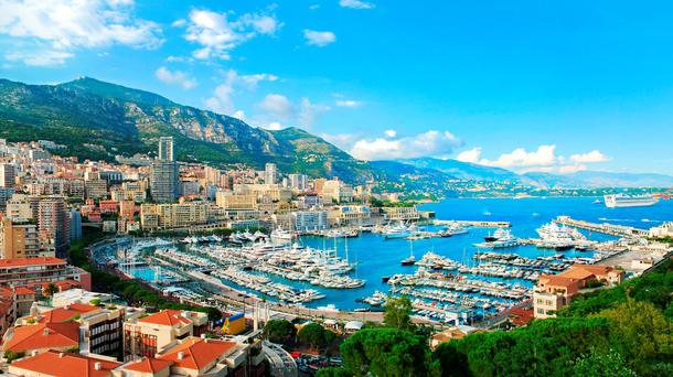 Monte Carlo city panorama. View of luxury yachts and apartments in harbor of Monaco, Cote d'Azur.
