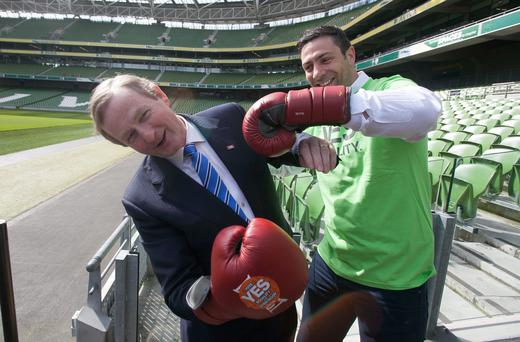 Taoiseach Enda Kenny with boxer and Fine Gael councillor Kenny Egan, lending their support to the 'Yes for Equality' campaign with other sports stars at the Aviva Stadium in Dublin yesterday. Photo: Gareth Chaney