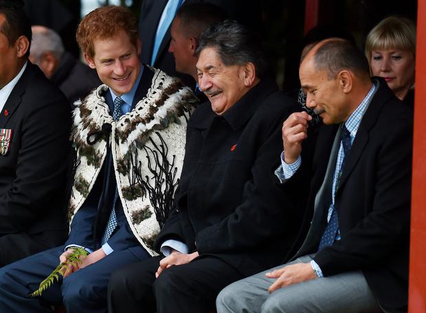 Prince Harry wears a traditional cloak during a visit to the Putiki marae, which is central to Maori culture and community activities in Whanganui, on the latest leg of his tour of New Zealand.