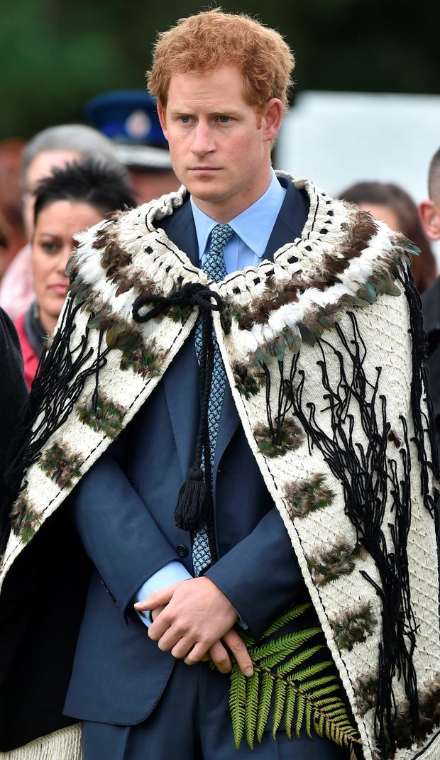 Prince Harry wears a traditional cloak as he arrives at the Putiki marae, which is central to Maori culture and community activities in Whanganui, on the latest leg of his tour of New Zealand.