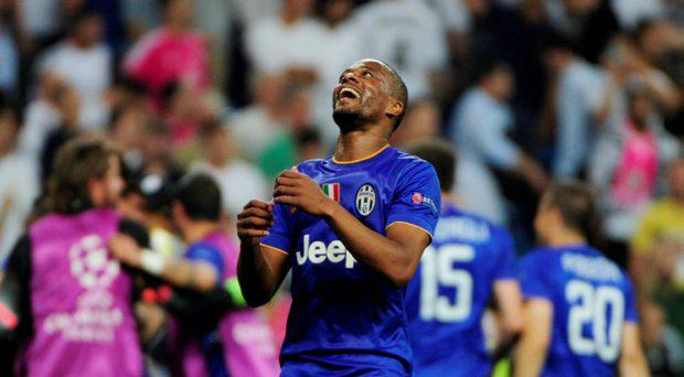 Juventus' French defender Patrice Evra celebrates winning the UEFA Champions League semifinal second leg football match Real Madrid FC vs Juventus at the Santiago Bernabeu stadium in Madrid on May 13, 2015