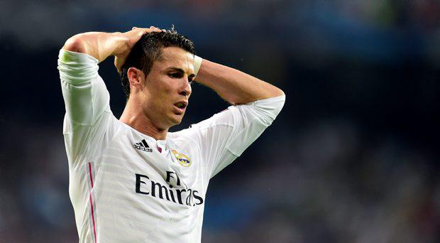 Real Madrid's Portuguese forward Cristiano Ronaldo reacts during the UEFA Champions League semi-final second leg football match Real Madrid FC vs Juventus at the Santiago Bernabeu stadium in Madrid on May 13, 2015
