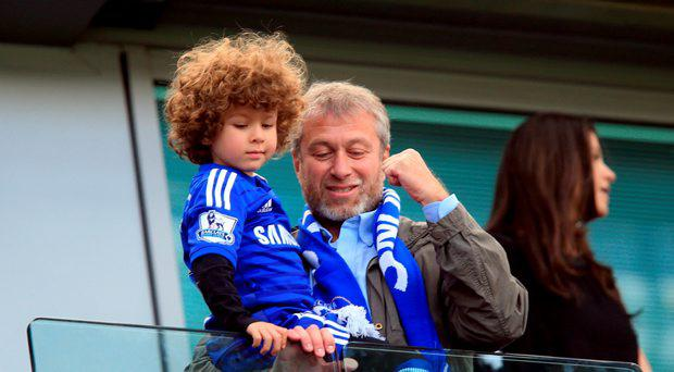 Chelsea owner Roman Abramovich celebrates in the stands with his son Aaron after they secure the title after the Barclays Premier League match at Stamford Bridge