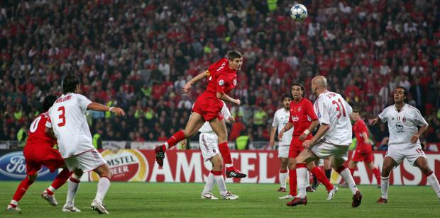 Liverpool's English midfielder Steven Gerrard (3rd L) scores a goal against AC Milan during their Champions League final win in 2005