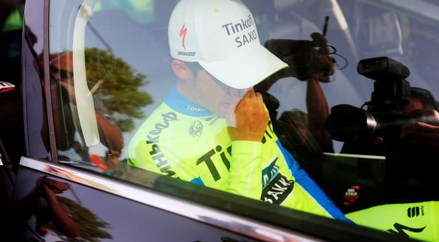 Spanish Alberto Contador is escorted to the hospital for medical tests following a crash at the end of the 6th stage of the Giro d'Italia
