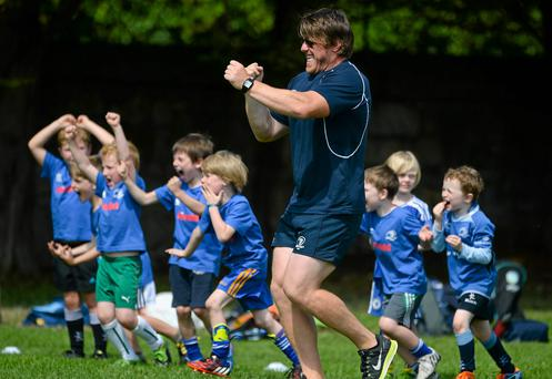 Coach Ken Knaggs and Under 6 players celebrate during the The Herald Leinster Rugby Summer Camps