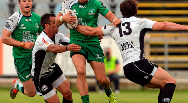 Tiernan O'Halloran attempts to skip through the Treviso defence during Connacht's victory in Italy